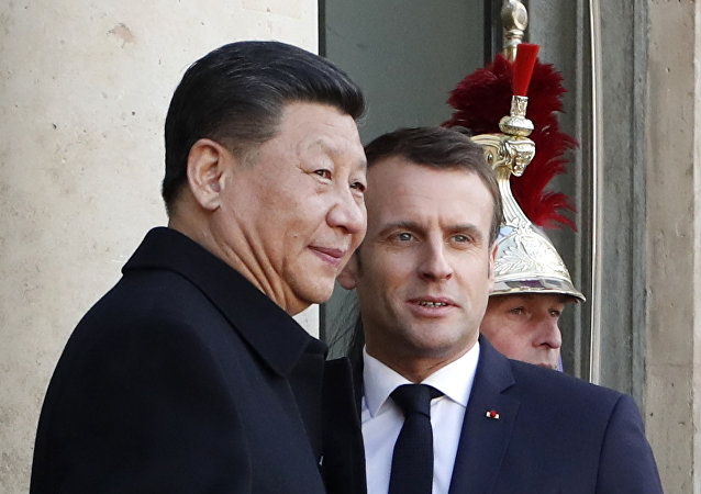 French President Emmanuel Macron, right, welcomes his Chinese counterpart Xi Jinping prior to a meeting at the Elysee Palace, in Paris, Monday, March 25, 2019.