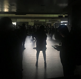 Passengers are seen during a blackout at Simon Bolivar international airport in Caracas, Venezuela March 25, 2019