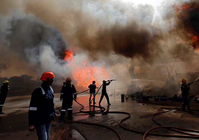 Firefighters attempt to douse a fire that broke out at a wood store in Ahmedabad, India, March 24, 2019