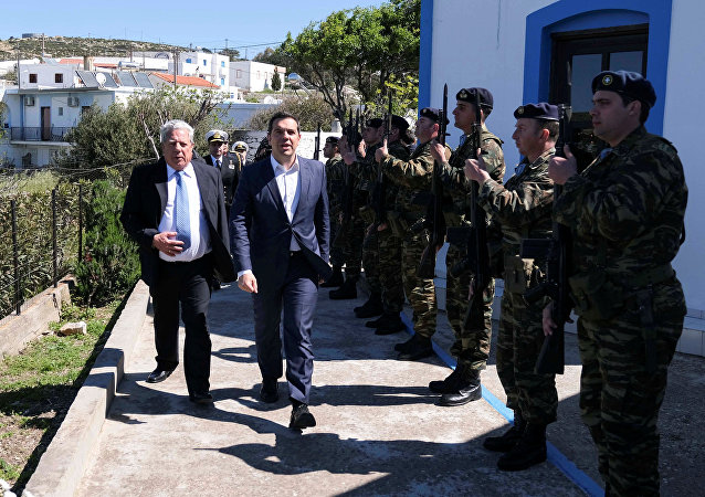 Greek Prime Minister Alexis Tsipras and Mayor of Agathonisi Evangelos Kottoros review a guard of honour during a visit on the island of Agathonisi, Greece March 25, 2019.