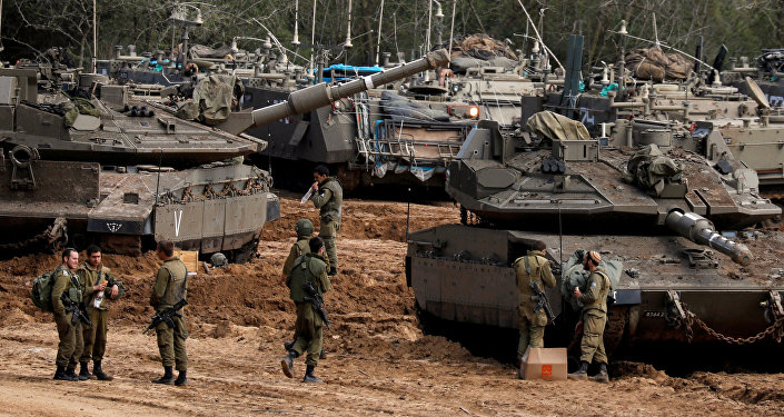 Israeli soldiers stand next to tanks and armoured personnel carriers (APC) near the border with Gaza, in southern Israel March 26, 2019.
