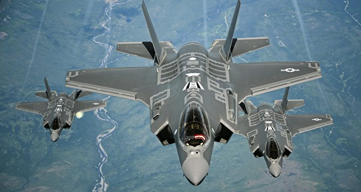F-35A Lightning II aircraft receive fuel from a KC-10 Extender from Travis Air Force Base, Calif., July 13, 2015, during a flight from England to the U.S. The fighters were returning to Luke AFB, Ariz., after participating in the world's largest air show, the Royal International Air Tattoo.