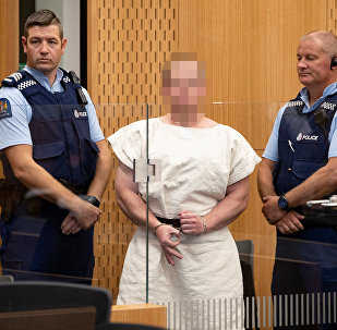 Brenton Tarrant, charged for murder, making a sign to the camera during his appearance in the Christchurch District Court, New Zealand March 16, 2019