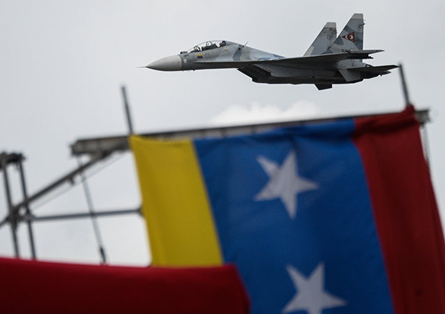 Russian-made Venezuelan Air Force Sukhoi Su-30MKV multirole strike fighters overfly a military parade to celebrate Venezuela's 206th anniversary of its Independence in Caracas on July 5, 2017