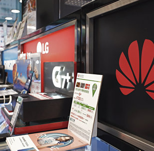 A Huawei logo is displayed at a electronic retail shop in Hong Kong, 29 March 2019.