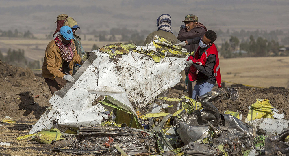 Rescuers work at the scene of an Ethiopian Airlines flight crash near Bishoftu, or Debre Zeit, south of Addis Ababa, Ethiopia, Monday, March 11, 2019