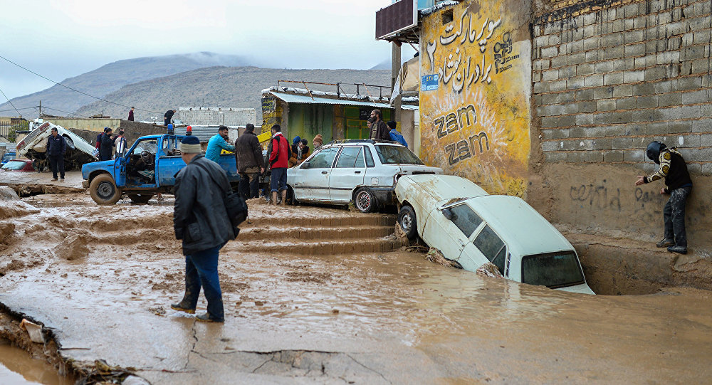 Damaged vehicles are seen after a flash flooding in Shiraz, Iran, March 26, 2019