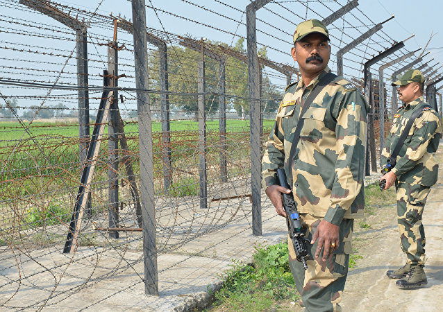 Indian Border Security Force personnel walk along a fence at the India Pakistan border on the outskirts of Amritsar on February 27, 2019
