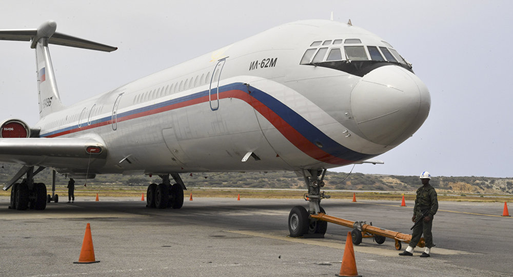 A Russian Ilyushin Il-62M Air Force plane, one of the two Russian military planes that arrived with troops and equipment to Venezuela last weekend, sits on the tamrac at Simon Bolivar International Airport on March 29, 2019 in Maiquetia, Vargas state, northern Venezuela