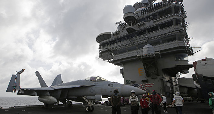 An F/A-18 Super Hornet fighter jet is seen on the deck of the U.S. Navy USS Ronald Reagan in the South China Sea