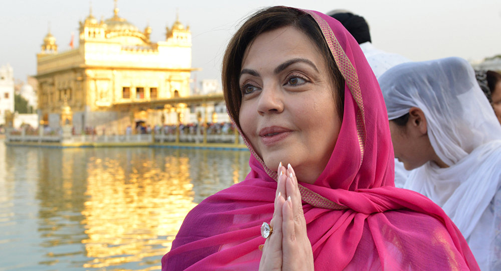 Indian businessman woman and Mumbai Indians team owner Nita Ambani (C) pay respect at the Sikh Shrine Golden Temple in Amritsar on March 30,2019