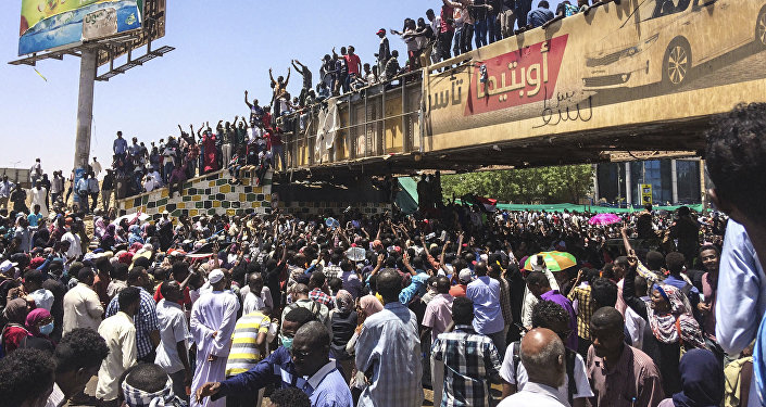 Protesters rally in front of the military headquarters in the capital Khartoum, Sudan, Monday, April 8, 2019