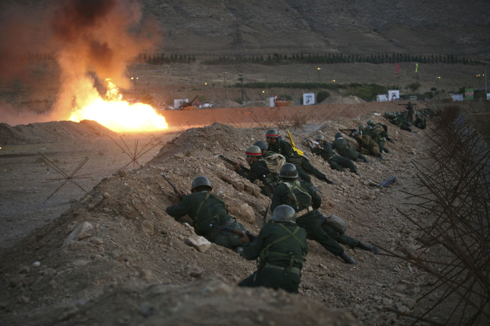 Members of Iran's Revolutionary Guards Take Their Positions During Maneuvers in a Suburb of Tehran