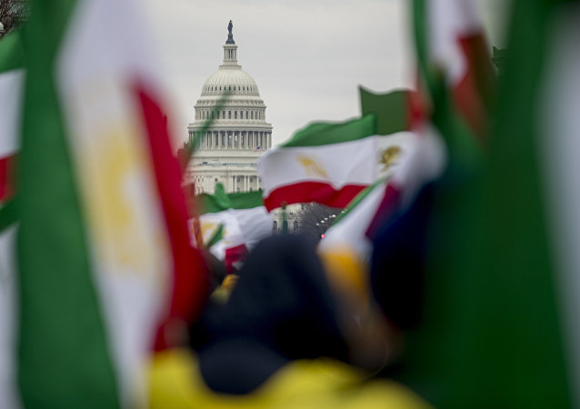The Dome of the U.S. Capitol building is visible through Iranian flags during an Organization of Iranian-American Communities rally at Freedom Plaza in Washington, Friday, March 8, 2019. (AP Photo/Andrew Harnik)