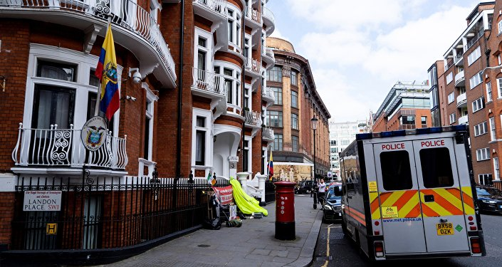 A police van is pictured outside of the Embassy of Ecuador in London on April 11, 2019, after police arrested WikiLeaks founder Julian Assange