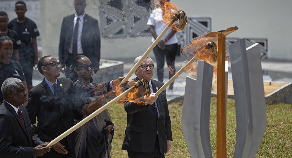 From left to right, Chairperson of the African Union Commission Moussa Faki Mahamat, Rwanda's President Paul Kagame, Rwanda's First Lady Jeannette Kagame, and President of the European Commission Jean-Claude Juncker, light the flame of remembrance at the Kigali Genocide Memorial in Kigali, Rwanda, Sunday, April 7, 2019.