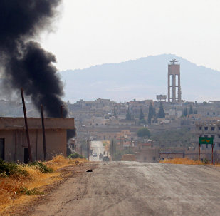 Smoke rises from Taybat al Imam town after rebel fighters from the hardline jihadist Jund al-Aqsa advanced in the town in Hama province, Syria August 31, 2016.(archives)