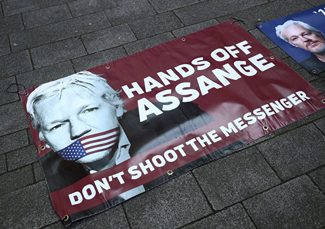 Banners in support of arrested WikiLeaks founder Julian Assange are seen on the pavement in front of Westminster Magistrates Court in London