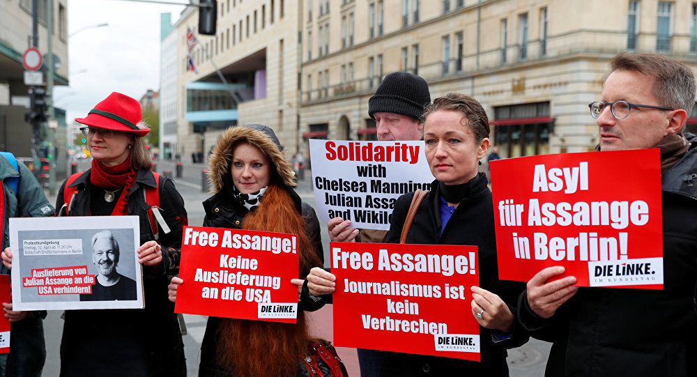 Supporters of WikiLeaks founder Julian Assange protest against his arrest, near the British embassy in Berlin, Germany April 12, 2019. The signs read: No extradition to the U.S., Journalism is not a crime and Asylum for Assange in Berlin.