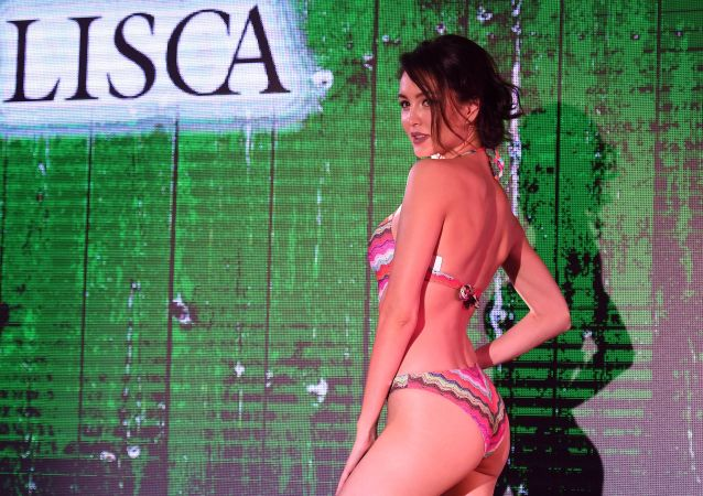 A Model Displays Swimwear on the Catwalk During Lingerie Fashion Week