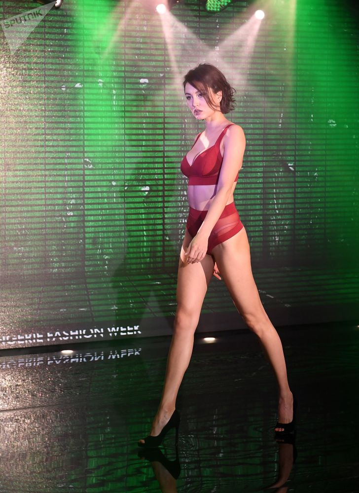 A Model Displays Lingerie While on the Catwalk During Lingerie Fashion Week