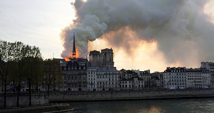 Smoke billows from the Notre Dame Cathedral after a fire broke out, in Paris, France, April 15, 2019.