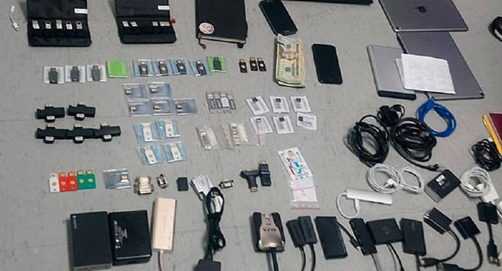 This Friday, April 12, 2019 handout photo provided by the State Attorney General's Office, shows items confiscated from the Ecuadorian residence of Swedish programmer Ola Bini, who was arrested Thursday, April 11, 2019, at the airport in Quito, Ecuador, while preparing to board a flight to Japan.