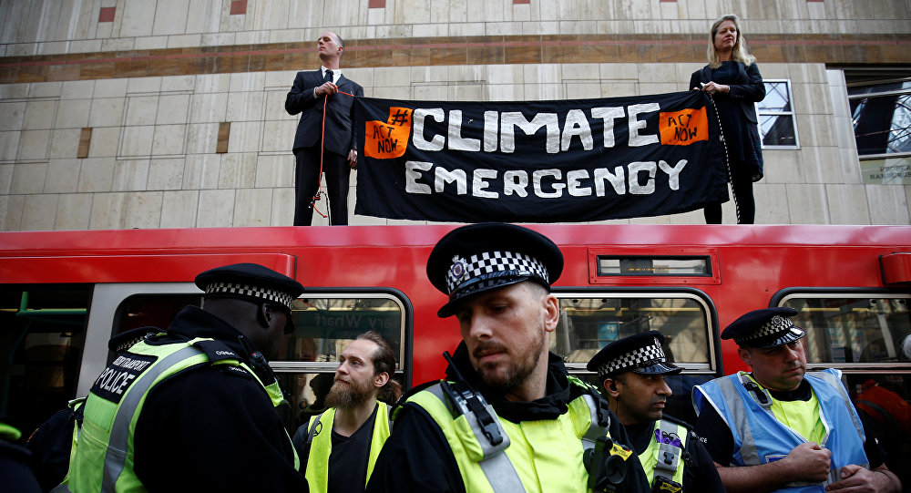 Police is seen as climate change activists demonstrate during the Extinction Rebellion protest, at Canary Wharf DLR station in London, Britain April 17, 2019.