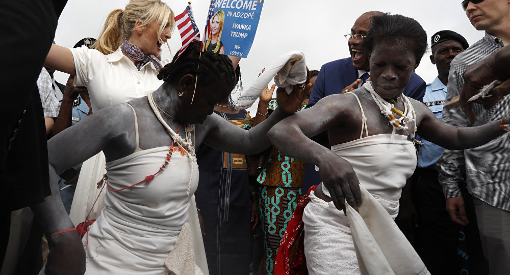 U.S. White House senior adviser Ivanka Trump, back left, joins in with traditional dancers as she is welcomed by local people on arrival to Adzope, Ivory Coast, Wednesday April 17, 2019, where she will visit Cayat, a cocoa and coffee collective