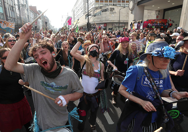 Climate change activists attend the Extinction Rebellion protest at Oxford Circus in London, Britain April 18, 2019.