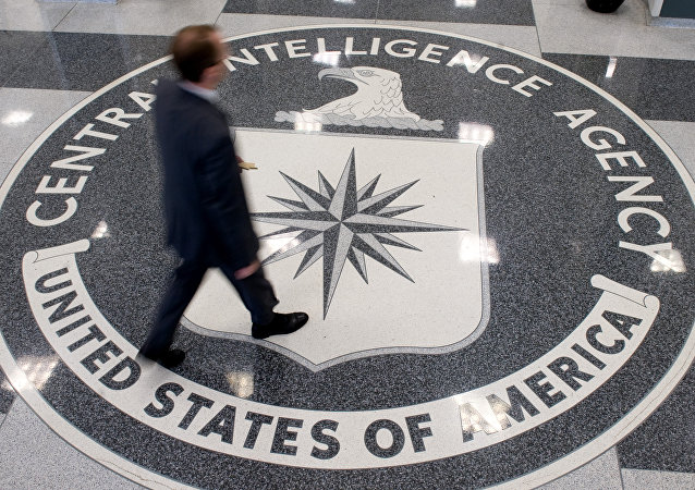 A man crosses the Central Intelligence Agency (CIA) seal in the lobby of CIA Headquarters in Langley, Virginia, on August 14, 2008.