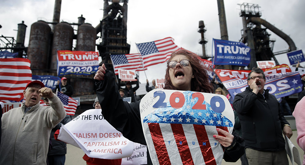 Protesters demonstrate in support of President Donald Trump near a Fox News town-hall style event with U.S. Sen. Bernie Sanders, Monday, April 15, 2019, in Bethlehem, Pa.
