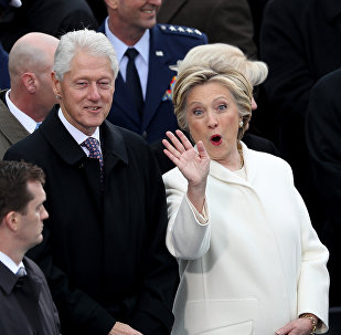 WASHINGTON, DC - JANUARY 20: Former President Bill Clinton and former Democratic presidential nominee Hillary Clinton stand on the West Front of the U.S. Capitol on January 20, 2017 in Washington, DC.