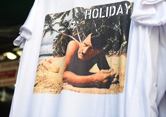 This photo taken on February 27, 2019, shows a t-shirt with a picture depicting a nude Adolf Hitler on a beach for sale at a street market for tourists in Bangkok