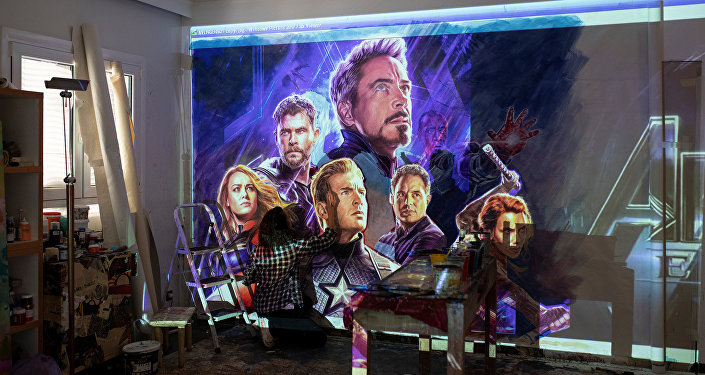 Greek artist Virginia Axioti works on the billboard of the Avengers: Endgame movie in Athens, Greece, April 21, 2019. Picture taken April 21, 2019