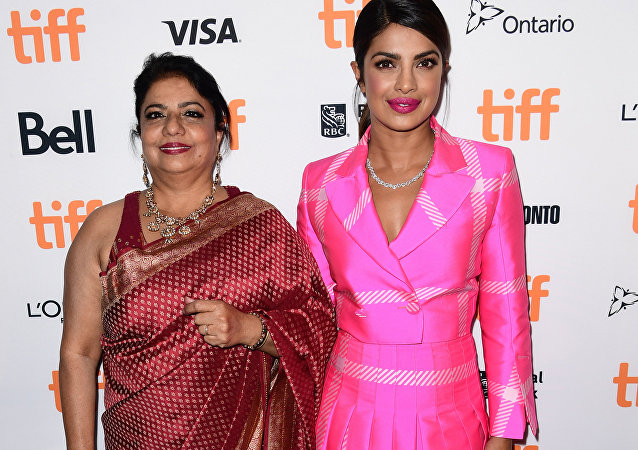 Madhu Chopra (L) and Priyanka Chopra attend the 'Pahuna: The Little Visitors' premiere during the 2017 Toronto International Film Festival at Scotiabank Theatre on September 7, 2017 in Toronto, Canada