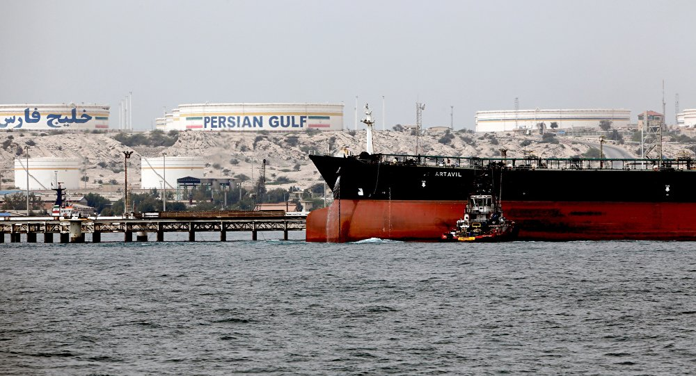 A picture taken on March 12, 2017, shows an Iranian tanker docking at the platform of the oil facility in the Khark Island, on the shore of the Gulf