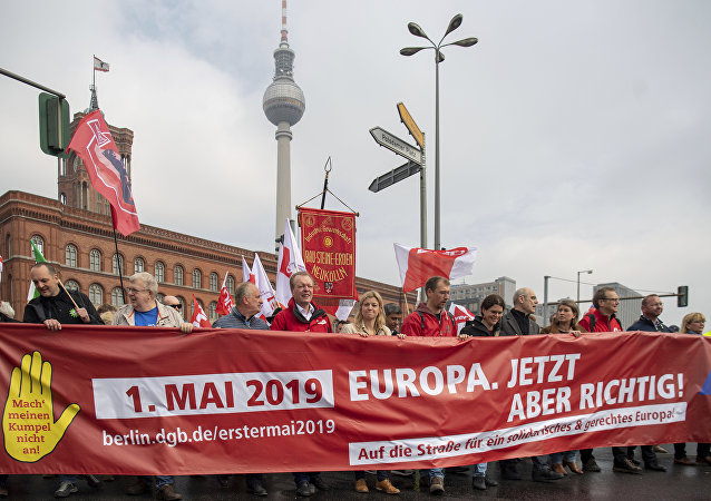 People march in the city centre of Berlin, Germany, during a traditional May Day demonstration of trade unions