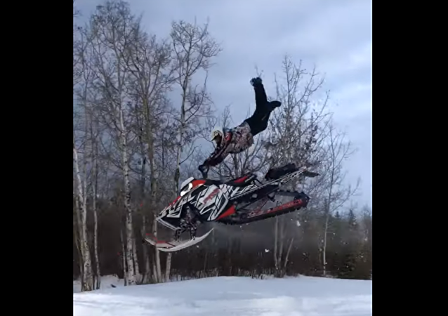 Superman! Snowmobile Catches Major Air, Ejects Driver