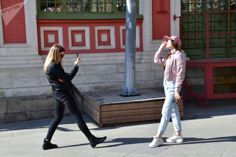 Girls Taking Pictures at Nikolskaya Street in Moscow