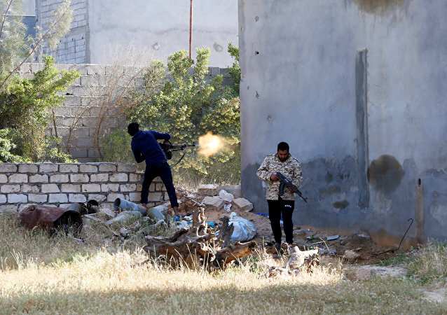 A member of the Libyan internationally-recognized government forces fires during a fight with Eastern forces in Ain Zara, Tripoli, Libya April 28, 2019