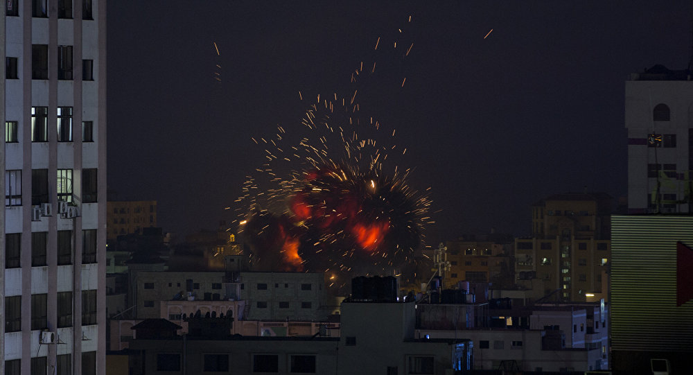 An explosion caused by an Israeli airstrike on a building in Gaza City, Saturday, May 4, 2019