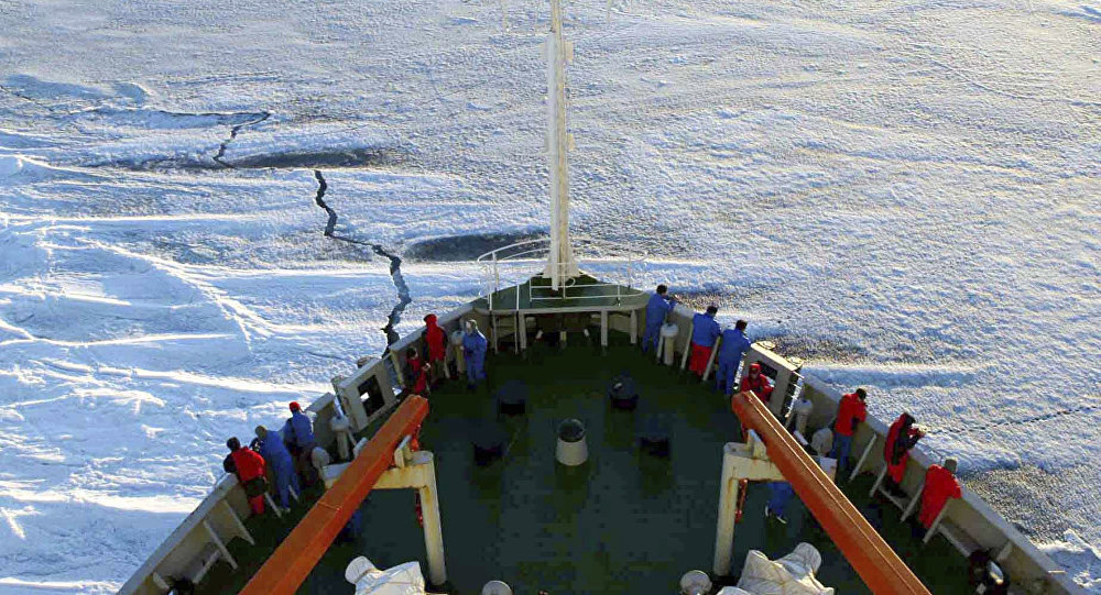 In this Dec. 17, 2005 file photo released by Xinhua News Agency, members of the Chinese Antarctica Research Team wait for the arrival at the continent on board of the polar expedition ship Xuelong