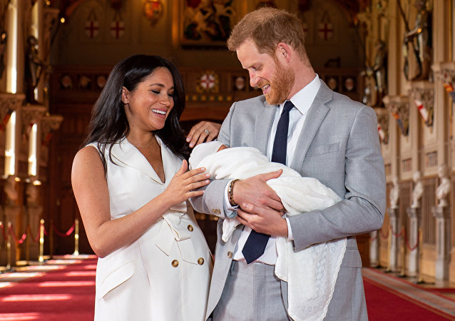 Britain's Prince Harry and Meghan, Duchess of Sussex are seen with their baby son, who was born on Monday morning, during a photocall in St George's Hall at Windsor Castle, in Berkshire, Britain May 8, 2019