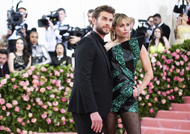 Liam Hemsworth and Miley Cyrus attend The Metropolitan Museum of Art's Costume Institute benefit gala celebrating the opening of the Camp: Notes on Fashion exhibition on Monday, May 6, 2019, in New York