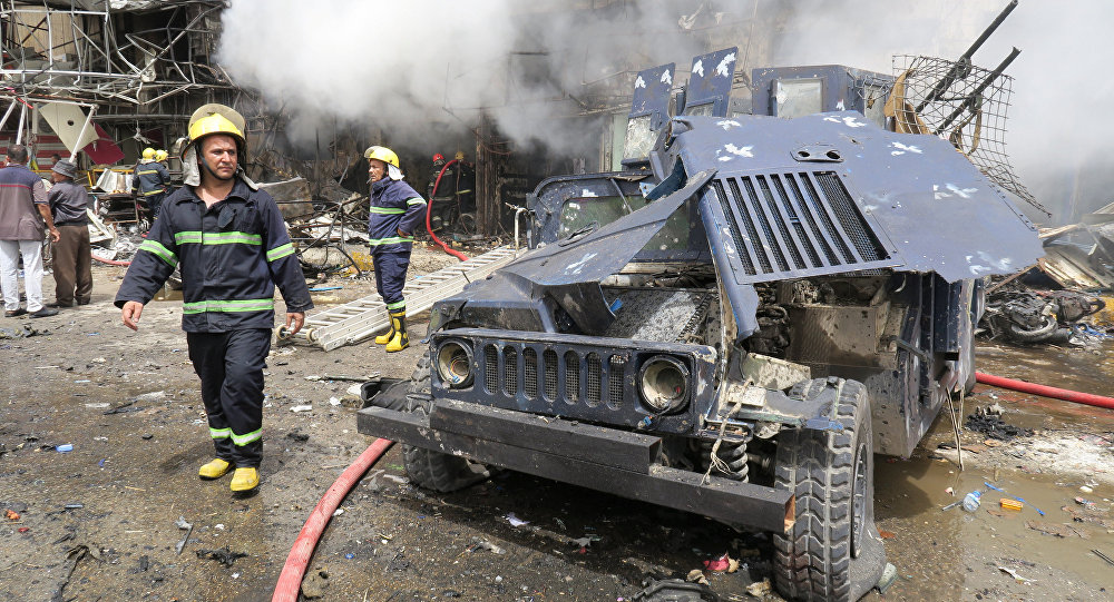 A damaged vehicle of the Iraqi security forces is seen at the site of a car bomb attack in Baghdad al-Jadeeda