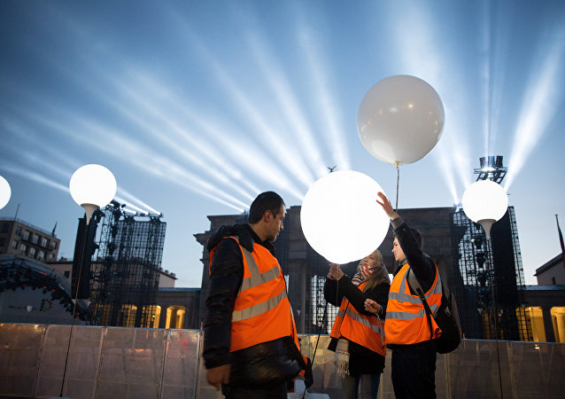 balloons filled with helium in front of Brandenburg Gate in Berlin