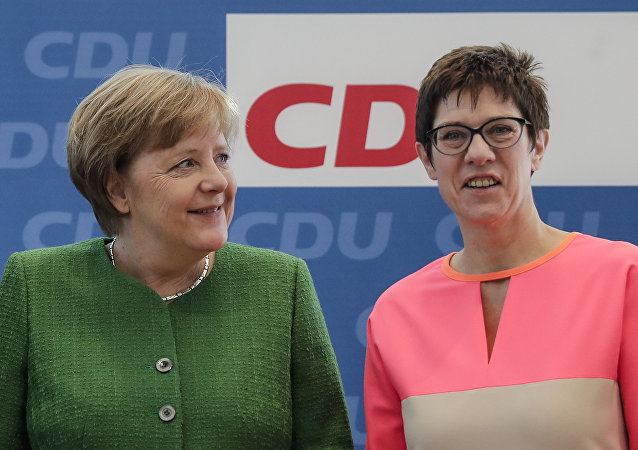 German Chancellor Angela Merkel, left, and the governor of German Saarland state and designated Christian Democratic Union party General Secretary, Annegret Kramp-Karrenbauer, right, attend a party leaders' meeting in Berlin, Germany. 19 February, 2018