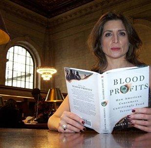 Vanessa Neumann with Her Book
