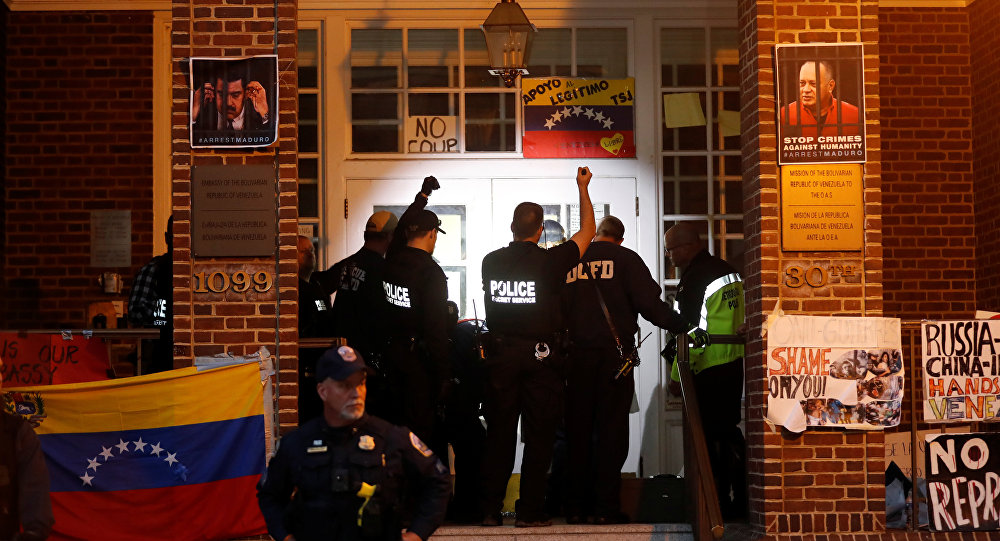 United States Secret Service agents prepare to enter the Venezuelan Embassy to evict and arrest the final four supporters of Venezuelan President Nicolas Maduro in Washington